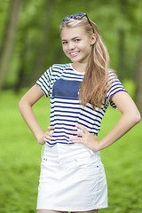 Happy Smiling Teenage Giwl in Striped T-Shirt Posing Outdoors in Forest. (DmitryMorgan) Tags: 1 1319years attractive beautiful blond blondyhair casual caucasian cheerful concept cute day enjoying female forest happy holidays joyful leisure leisureactivity lifestyle lifetime lovely one outdoors park positive relaxing skirt smiling standing stripe stripy stylish summer sunglasses sunny teen teenager vacation white younggirl youth