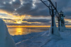 Icy Sunset (tquist24) Tags: hdr lakemichigan michigan nikon nikond5300 stjoseph clouds cold evening frozen geotagged ice lake lighthouse oudoors reflection reflections sky sunset water winter