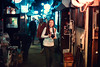 Golden Gai Adventure (Jon Siegel) Tags: nikon nikkor d810 50mm 12 nikon50mmf12 50mm12ais woman girl beautiful alleyway night evening glow lights lanterns japan tokyo goldengai shinjuku