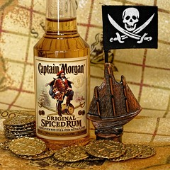 Yo-ho-ho and a bottle of rum (Dragon Whale) Tags: macromondays inspiredbyasong rum pirates treasure map piecesofeight skullandcrossbones captainmorgan robertlouisstevenson goldcoins
