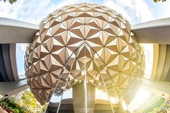 Spaceship Earth Sunset (NOLA_2T) Tags: trip vacation florida orlando waltdisneyworld disneyworld baylake epcot experimentalprototypecommunityoftomorrow spaceshipearth sse geodesicsphere sun flare sunset rokinon vivitar samyang 12mm 28 fisheye fullframe nikon d610 distortion symmetry yellow blue clouds triangle family love