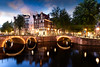 Amsterdam Canal and Light (beatricepreve) Tags: amsterdam architecture benelux blue bridge canal capital city cityscape color colorful colour colourful copyspace dusk dutch europe european evening glow golden gracht historic holland hour house illuminated illumination kanaal keizersgracht landmark light lights lit mood moody motion nederland netherlands night nightlife old orange picturesque red romantic tail trails water yellow