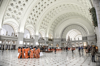 Witness Against Torture Demonstrators Huddle in the Lobby at Union Station to Discuss Their Next Action