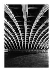 under the bridge (stillshunter) Tags: uk bridge blackandwhite bw london monochrome thames blackwhite unitedkingdom structure d76 ilfordhp5 hp5 underthebridge ilfordhp5plus kodakd76 leicam4p kodakd7611