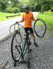 Helping Rachel Fix Flat Tire on Beach Drive (Mr.TinDC) Tags: ted me md maryland biking flattire mrt mrtindc bechdrive