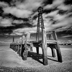 The Old jetty, Lytham St Anne's pier (High Peak and Lowland) Tags: blackandwhite heritage rotting monochrome square coast wooden sand ruins wideangle lancashire coastal historical lythamstannes oldjetty sigma1020mm stannespier pentaxk5 moodymono jimennisphotography