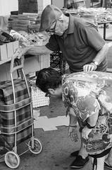 One size fits all (krakeel) Tags: street bw 50mm spain nikon shoes market espana catalunya markt schoenen oldercouple palafrugell straatfotografie d7000