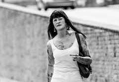 Scarborough Ink (EightBitTony) Tags: uk england blackandwhite bw woman monochrome tattoo female person blackwhite unitedkingdom streetphotography tattoos gb scarborough earrings northyorkshire