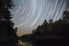 Polaris and Friends, with Special Guests, the Perseids (Matt Molloy) Tags: mattmolloy timelapse photography timestack photostack movememnt motion night sky stars trails meteors shootingstars startrails lines circles airplanes lake water reflections trees burnthills ontario canada landscape nature lovelife persieds