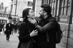 The Gentle Touch (Cliff.j) Tags: street london candid couple outdoor monument touch smile moment city affection bokeh sony a7 carl zeiss sonnar 55mm bw love happy depth of field beard