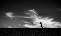 dike walk (Dan-Schneider) Tags: streetphotography schwarzweiss blackandwhite bw monochrome clouds silhouette sky mood sea minimalism light solitude