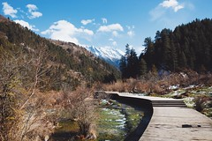 Winter at Jiuzhaigou (dyorex) Tags: china sichuan jiuzhai jiuzhaigou valley landscape nature travel color colorful light lighting sunlight forest tree nikon mountain lake water morning winter reflection park sky clouds snow trail river