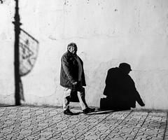 Going home (Georgie Pauwels) Tags: street shadows morocco sunlight wall streetphotography olympus moment blackandwhite candid