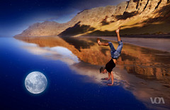 Dive into the Sky (El Orfebre Mochilero) Tags: moon sky night stars fly dive oniric dream scape freedom guy young boy beach landscape mountains cliffs rocks shore water barefoot clouds red orange fall jump reflection jeans tshirt couple upsidedown lanzarote famara canary islands outdoor
