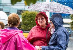 Enjoying the Weather (The Image Den) Tags: people rain weather umbrella candid streetphotography hampshire southampton towncentre britishweather pacamac