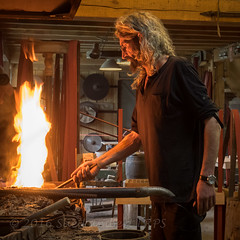Eric the knifemaker at his forge (Nanooki) Tags: orange france fire glow blacksmith artisan knifemaker midipyrenees coutellerie may2015 theariège manzacdenbas france2015 wwwcoutellerieinfo ericbousset