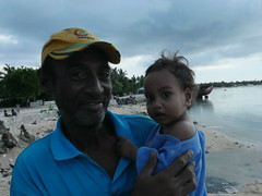 A local Betio father and his grand daughter. He was conserned about the rising sea levels and asked me what i tought was going to happend. Not the usual conversation to have, but a very special moment!