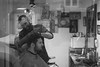 Copenhagens British Barber (cohenvandervelde) Tags: 35mm 550d bw blackwhite canon550d city cohenvandervelde creativecommons denmark explore faces flickr scene scout snap worldstreetphotography camera candid canon monochrome people primelens shadow street streetphotography streettog unposed window