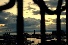 Find Genoa's symbol (moniq84) Tags: liguria sunrise sunrises sunset sunsets sun clouds sole nuvole tramonto controluce backlight contre jour ghesemmu genoa spianata castelletto port ships boats buildings italia italy italie seascapes seascape skyline cityscapes cityscape