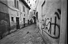 """ Why ? "" (pigianca) Tags: italy siena walls writer monochrome blackwhite streetphoto urbanphoto leicam6 voigtlanderheliar15mmf45iii"