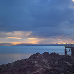Wellington point (Lesmacphotos) Tags: wellingtonpoint sunrise beach sea pier landscape water clouds rocks jetty island shaftoflight sun