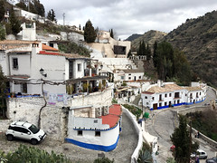 Cave village - and mind the very narrow street (roomman) Tags: 2017 spain granada albaycin old town meet meeting andalucia andalusia cave village valley steep gipsy house houses narrow very street road path car cueva cuevas sacremonte monte sacre sacred hill hilly deep