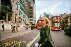 Everything In The Street Today Seems Beautiful (Steve Lundqvist) Tags: woman donna dress busy union jack car van england inghilterra uk english london londra rich groomed well street portrait dressed grooming shirt top blouse womenswear jacket leather sunglasses streetphotography bus road strada