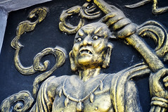 Scary guy (Roving I) Tags: bronze relief carvings characters stories entrances temples pagoda respect beliefs buddhism hoian tourism tradition vietnam