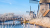 Molens in een winters decor. (pierre bakker) Tags: oterleek noordholland netherlands nl nederland northholland winter cold ice molens mills bridge brug