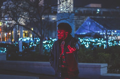 Lucky (MeganMonique.) Tags: portrait portraiture portraits man men people night park atl atlanta atlantaphotography atlantaphotographer meganmonique meganmoniquephotography bokeh nightphotography nightlife nightlight original travel christmas newyears mensfashion red blue green turquoise canopy downtown atlantanightlife shrubbery trees outside outdoors black brown white