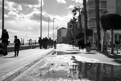 sunday ride after the rain (pepe amestoy) Tags: blackandwhite streetphotography people elcampello spain fujifilm xe1 voigtländer color skopar 2535 vm leica m mount