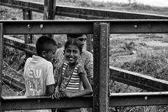 the smiling little girl- People of Sri Lanka (Claudia Merighi) Tags: blackandwhitephotos blackandwhiteonly blackwhitephotos streetphotography street streetphoto streetportrait streetphotographers monochromatic children fotografiadistrada fotografiacallejera pentax k3 claudiamerighi pretoebranco schwarzweisfotos strassenfotografie