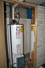 water heater plus one = lazy (McBeth) Tags: two wisconsin pair basement mapprinclude laziness househunting waterheaters poorinstallation scarycreepyhouse