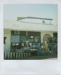 Wenatchee Junk and Gun Shop. (brettbigb) Tags: 2005 summer hot color kids fun polaroid washington amazing junk gun chairs yes awesome great roadtrip adventure brett tables target guns polaroids ladder goodtimes gunshop regular warn riffle easternwashington sasquatchfestival longtimeinsideacar polaroid's itmustbelove savepolaroid