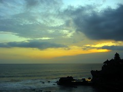 awan (Farl) Tags: travel blue sunset sea bali sun color colors beauty yellow indonesia temple waves horizon culture tradition hindu hinduism technique tanahlot candi