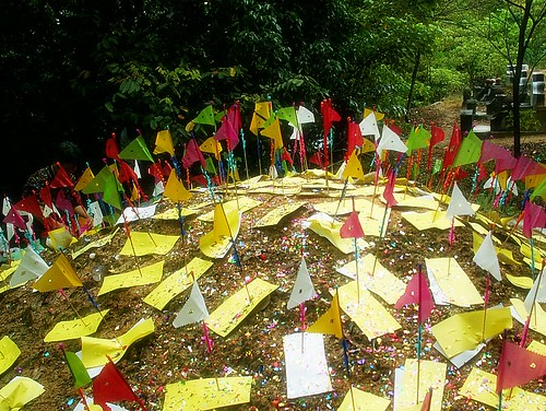 Colourful paper flags on a Chinese grave