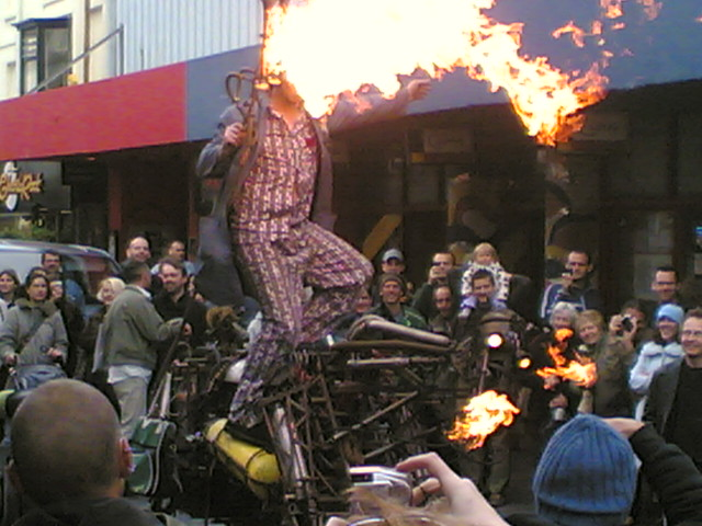 Man on fire breathing mechanical horse
