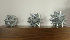 Woven polyhedra (Michał Kosmulski) Tags: origami modular unit polyhedra polypolyhedra himalayanpeaks wovenpolyhedron polypolyhedron wireframe robertjlang thomashull michałkosmulski metallicpaper silver grey gray shelf