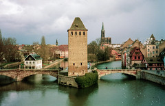 The Covered Bridge, Strasbourg (Cameron Booth) Tags: 2003 bridge vacation france church river geotagged canal europe cathedral gothic unescoworldheritagesite spire strasbourg alsace coveredbridge petitefrance basrhin scannedfromnegative strasbourgcathedral pontscouverts riverill cathdralenotredamedestrasbourg