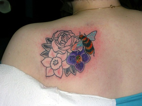4c19da642abcc bee tattoo. daffodil. flower tattoo bee tattoo. daffodil. flower tattoo. Violet  rose tattoo on the chest and red dragon tattoo armband.