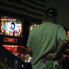 Giving the Finger(s) (Vemrion) Tags: old man guy topv111 bar pub missing hand arm finger flag injury forsakenpeople elderly american disabled pinball forsaken harm handicapped fitz disability