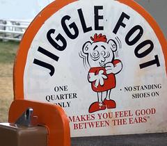 one-quarter (sillydog) Tags: 2005 oregon salem fair statefair oregonstatefair orange abstractobject rebranded vendingmachine funny jigglefoot