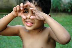 Little Sri Lankan boy (Mydaas!) Tags: srilanka asia asians boy colombo sanushka heenpella little cute gesture hands fingers smile shy green human fun