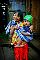 carrying her brother - portrait thailand baby sling phitar lahu carrying brother