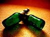 Dándole duro al vidrio (wakalani) Tags: old verde green beer bottle cerveza olympus nostalgia antigua dos vistas recuerdos par botella 1964 bebida greenglass fashioned vidrioverde rememberings olympusfe120 wakalani masvistas utatafeature