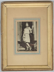 Young Girl---The Departure (Original Framing?) (mrwaterslide) Tags: antique old oldphoto vintage vernacular top20op girl younggirl train passengertrain watchyourstep handrail girlscout girlscoutuniform uniform newspaper winsome cute sweet lithesome woodenbeads necklace