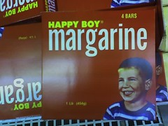 'Happy Boy' brand margarine, with creepy-looking blank-eyed 'smiling' kid on the box