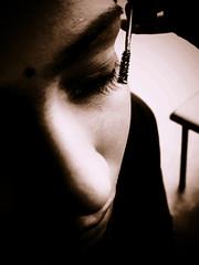 There Is No Cosmetic For Beauty Like Happiness (JourneyToNoWhere) Tags: light face closeup nose shadows floor lips eyebrow desaturated closeshot eyelid bwphotography tableleg inshadow humanface closedeye cheekbone partofaface 20051225christmas2005 halfofaface