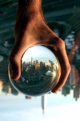Big hand, little city (.brian) Tags: city newyork topf25 1025fav interesting hand manhattan topv999 most refraction empirestatebuilding topv777 notphotoshopped glassball b51fav