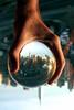 Big hand, little city (.brian) Tags: city newyork topf25 1025fav interesting hand manhattan topv999 most refraction empirestatebuilding topv777 notphotoshopped glassball b51fav